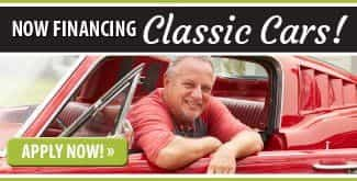 Now Financing Classic Cars. Photo of Man in Classic Car