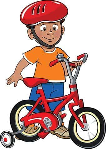 Boy wearing helmet with his bike.
